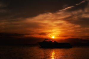 Boat sailing on the Caribbean Sea during a sunset HD