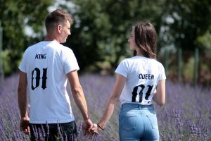 Lovely couple holding hands in a lavender field 4K