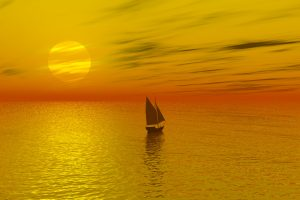 Sailboat crossing the sea during a sunset 4K