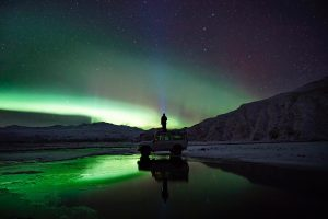 Man Looking At The Aurora Borealis 7K
