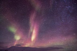 Starry Sky With Aurora Borealis Over Mountains 5K