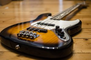 Bass guitar posed on the floor HD