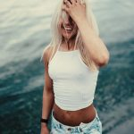 Cute Blonde Woman In Front Of The Sea