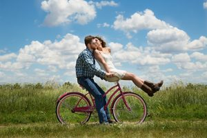 Loving Couple Riding On A Bike