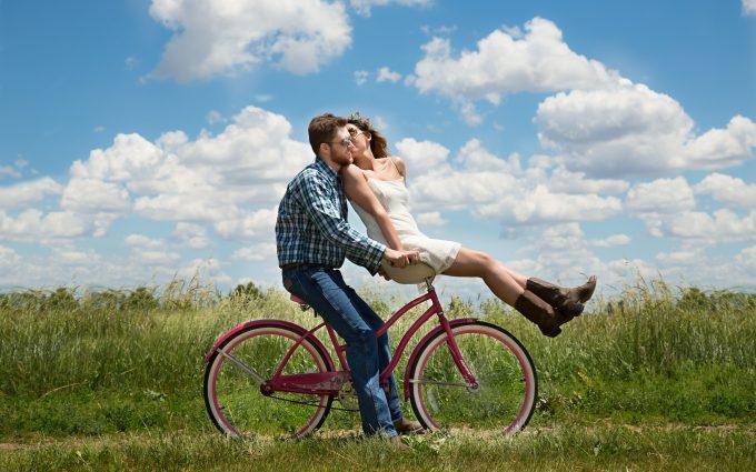 Loving Couple Riding On A Bike