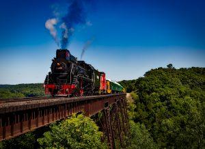 Steam Train crosses a bridge in the middle of nature HD