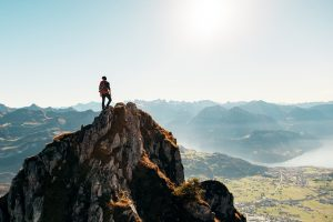 Hiker On Top Of A Mountain