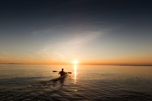 Kayaking During A Sunset