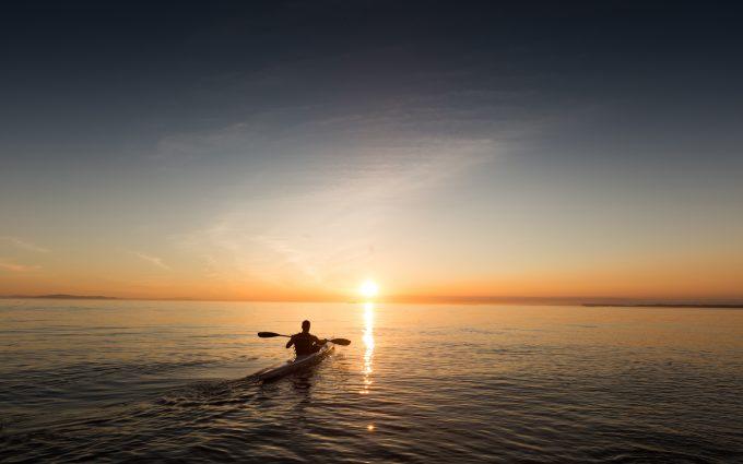 Kayaking During A Sunset