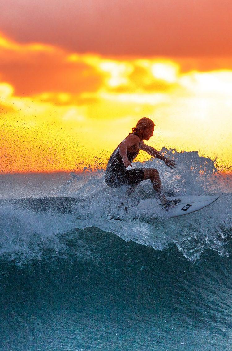 Man Surfing Waves At Sunset Hd Wallpaper