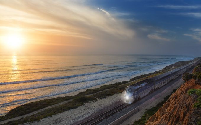 Train Passing In Front Of The Sea During A Sunset
