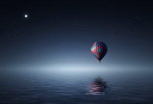 Hot Air Balloon Over The Ocean HD
