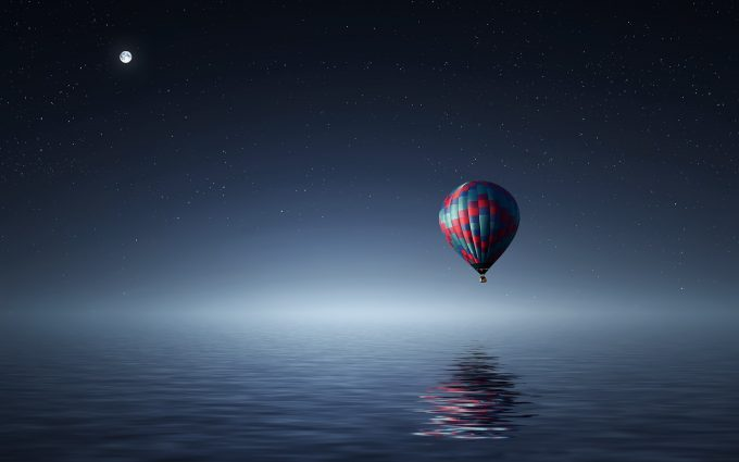 Hot Air Balloon Over The Ocean