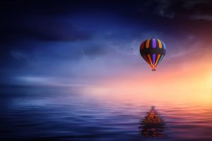 Hot Air Balloon Over The Ocean At Sunset