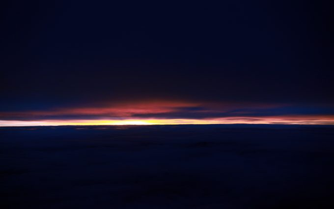 Sunset Above The Clouds
