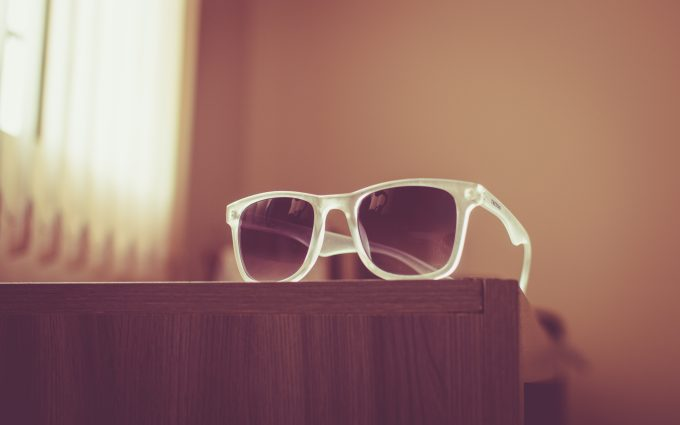 White Sunglasses Posed On The Table 6K