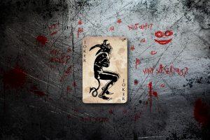 Joker Card Logo On Scratched Background 4K
