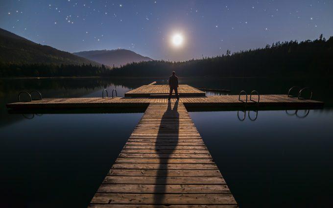 Man Contemplating Stars In British Columbia