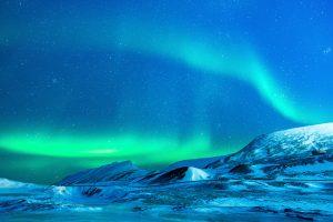 Aurora Borealis Over Snowy Mountains 4K