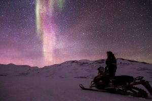 Contemplation Of An Aurora Borealis And The Milky Way On Snowmobile 5K