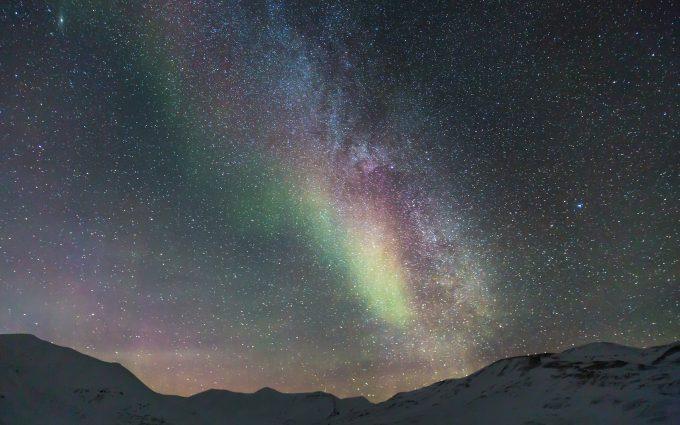 Milky Way With Aurora Borealis Over Snowy Mountains 5K