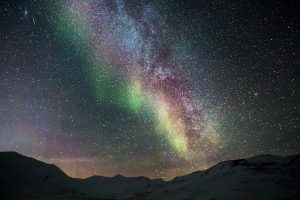 Starry Sky with Aurora Borealis Over Snowy Mountains 5K