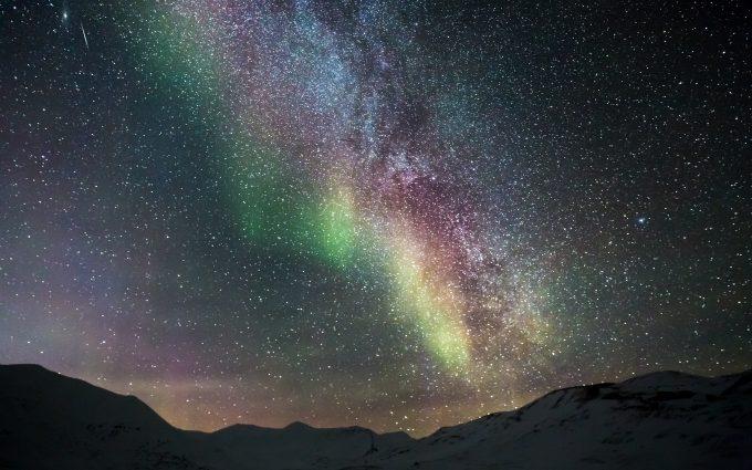 Starry Sky With Aurora Borealis Over Snowy Mountains 5K